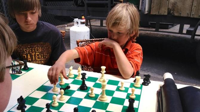 My son Josiah at a small chess tournament at a book fair.
