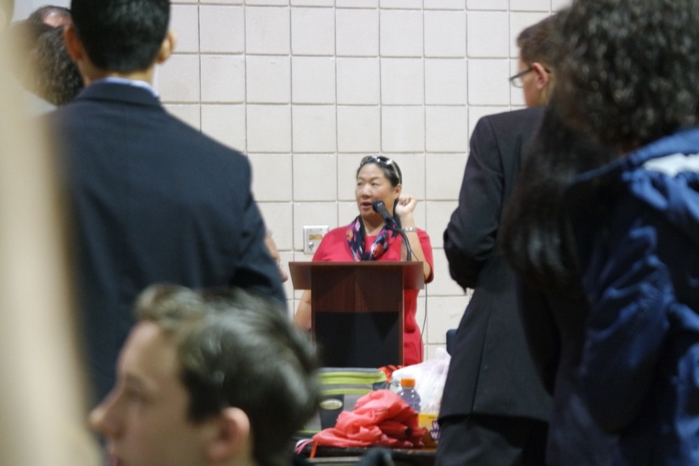 Tournament Director Joanne Quan giving announcements.